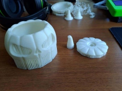 3D printed pumpkin before removing supports